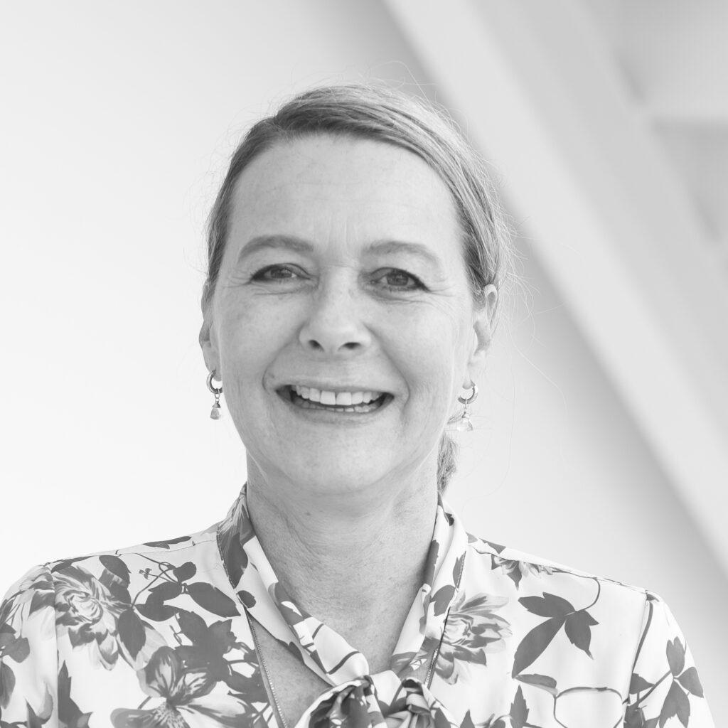 Monica Middleton - Black and White Headshot of white woman, smiling -